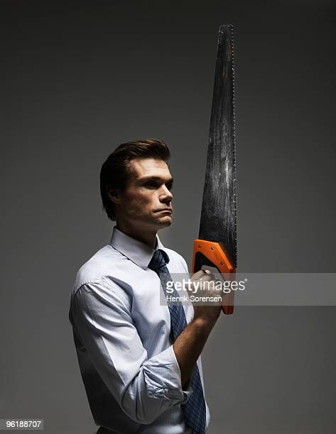 adult business male holding large saw