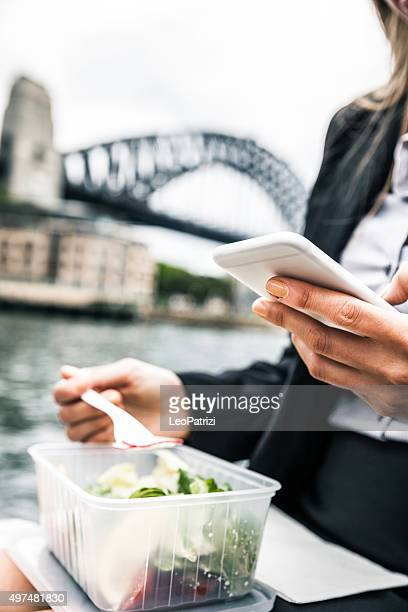 Adult businesswoman having a break eating salads in Sydney