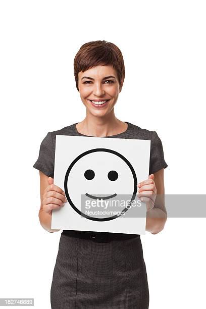 Adult Businesswoman Holding Happy Face Drawing Isolated on White