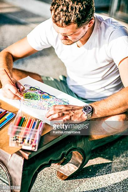 adult colouring with soft tip pencils, designer, handsome men - karina urmantseva stock pictures, royalty-free photos & images