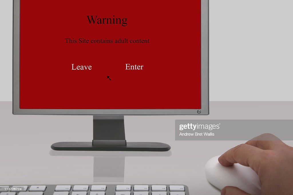 Adult content warning screen on a desktop computer : Stock Photo