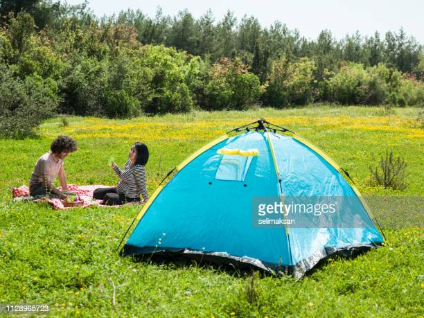 Adult Couple Camping In Nature During Springtime