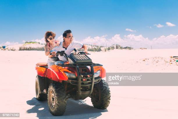 Adult couple driving off road ATV