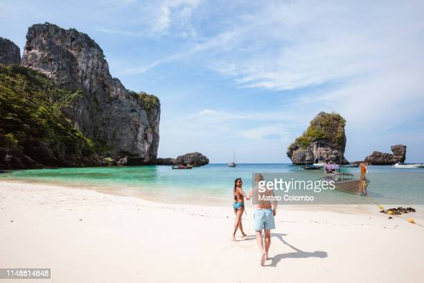 adult couple in swimsuit at the beach, phi phi islands, thailand - thailand stock pictures, royalty-free photos & images