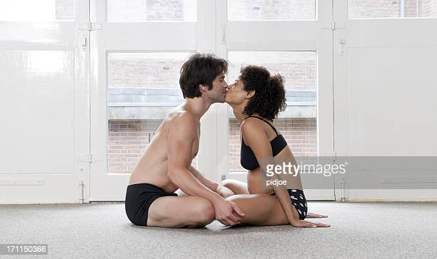 adult couple kissing in yoga studio