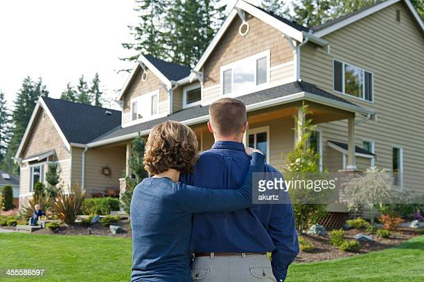 Adult couple looking at new home to purchase