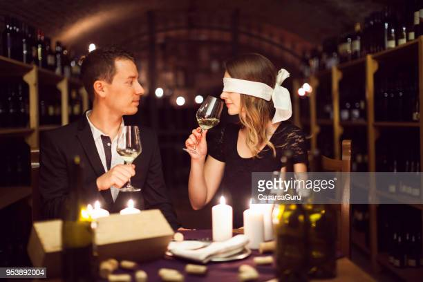 adult couple on blindfolded wine tasting date - blindfold stock pictures, royalty-free photos & images