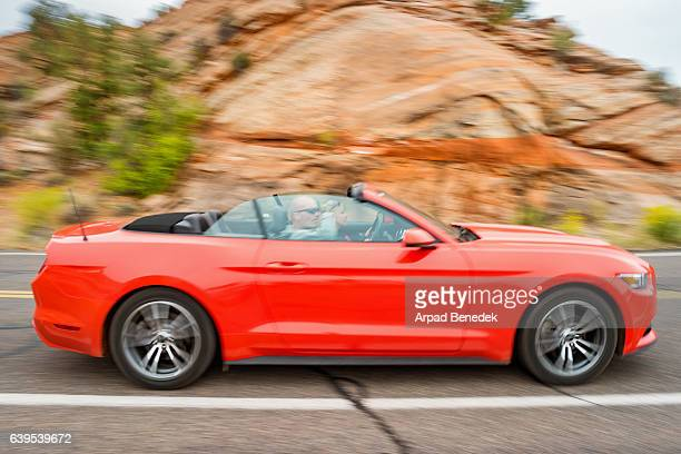 adult couple on roadtrip in utah usa - ford mustang stock photos and pictures
