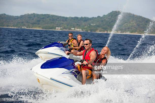 Adult couple riding jet boats