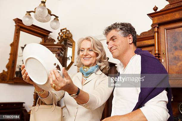 Adult couple shopping in an antique shop