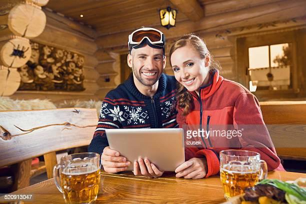 Adult couple using digital tablet