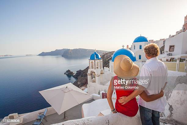 Adult couple watching sunset in Santorini, Greece