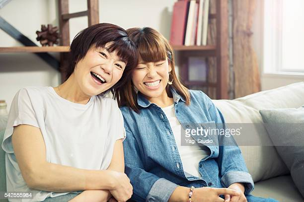 Adult daughter and mother having a good time