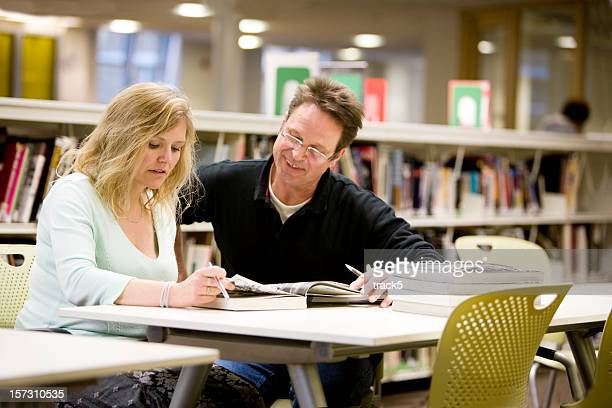 adult education: a couple of mature students studying together
