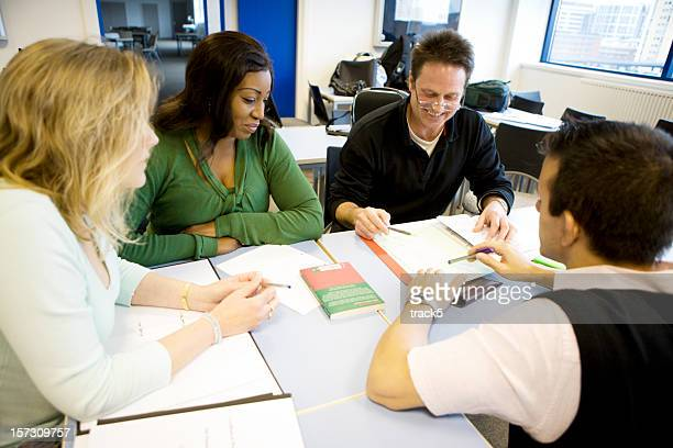 adult education: candid diverse group of mature students working together - staff meeting stock pictures, royalty-free photos & images