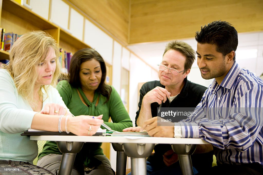 adult education: Diverse mature students working in their college library : Stock Photo