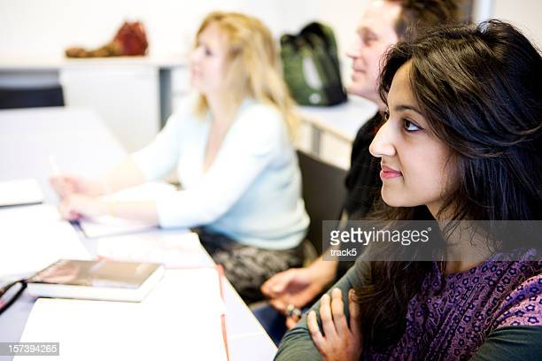 adult education: eager students listening intently to their class teacher