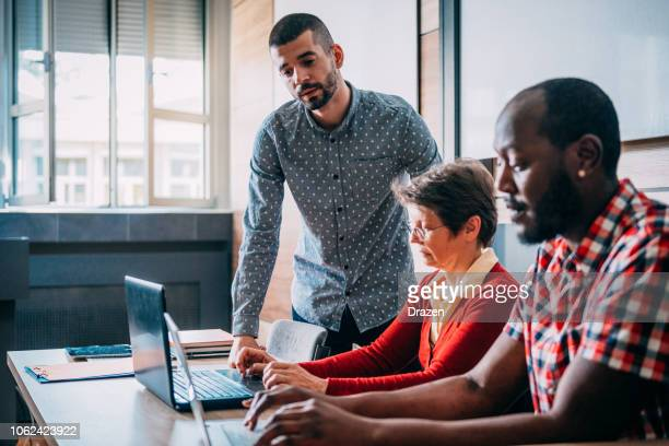 adult education for diverse group of mature adults - 35 39 years stock pictures, royalty-free photos & images