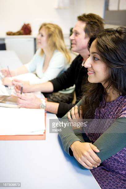 adult education: keen and attentive class of mature diverse students