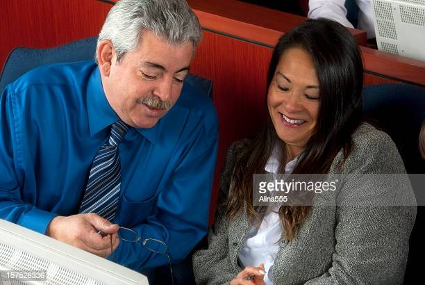 adult education: two colleagues at a training event discussing notes - alina stock pictures, royalty-free photos & images