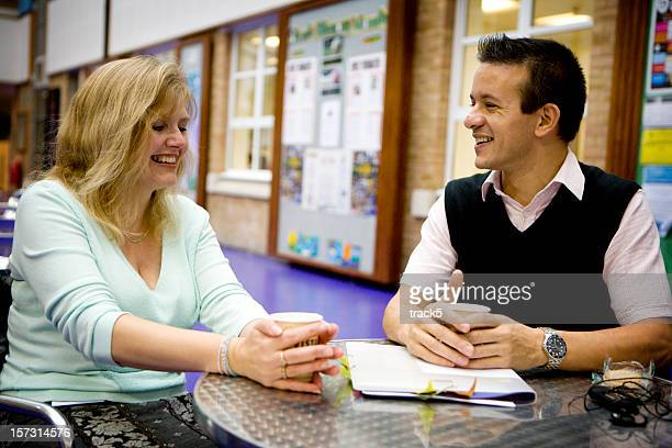 adult education: two mature students enjoying a break together
