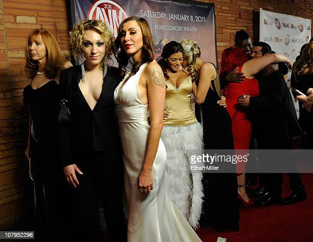Adult entertainers including Princess Donna and Lily LaBeau wait to be photographed as they arrive at the 28th annual Adult Video News Awards Show at...