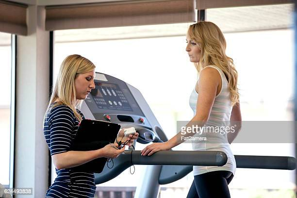Adult female patient walking on a treadmill for rehab