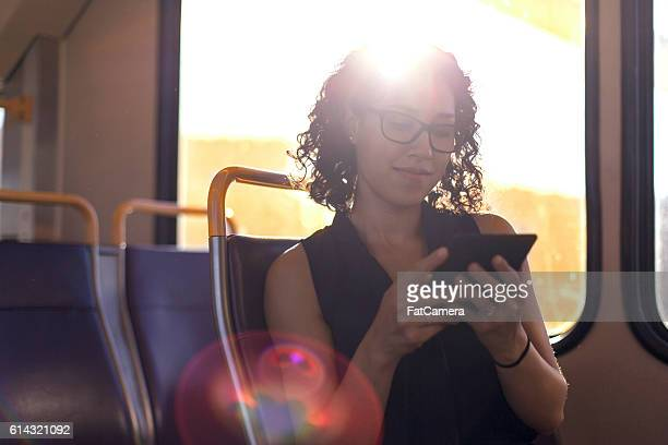 Adult female using a smart phone during her commute