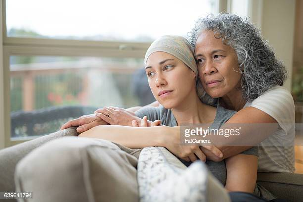 adult female with cancer being nurtured by her mature mother - terrified stock pictures, royalty-free photos & images