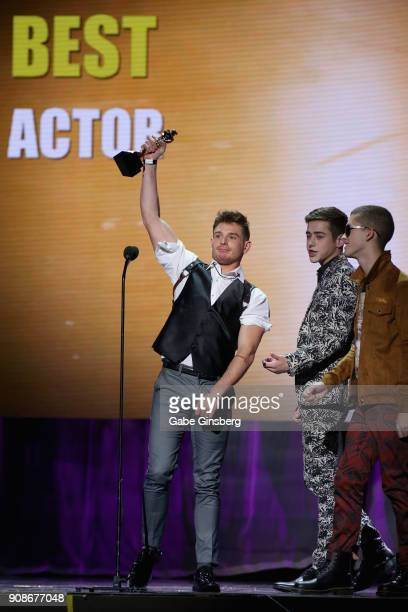 Adult film actor and director Brent Corrigan reacts to winning the Best Actor award while adult film actors Joey Mills and Sean Ford look on during...