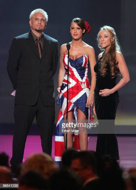 Adult film actor Barrett Blade and actresses McKenzie Lee and Tianna Lynn present an award at the Adult Video News Awards Show at the Venetian Resort...