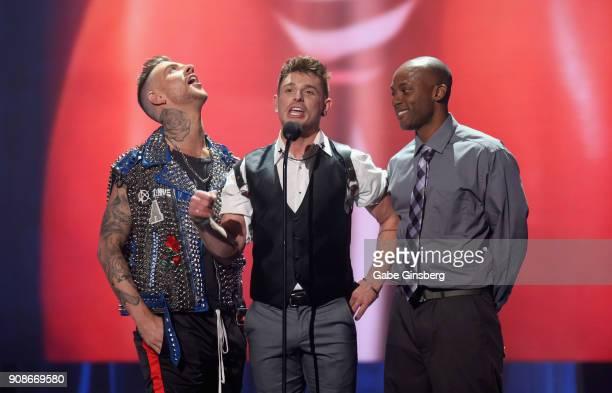 Adult film actor Danny Gunn adult film actor and director Brent Corrigan and adult film actor Osiris Blade present an award during the 2018 GayVN...