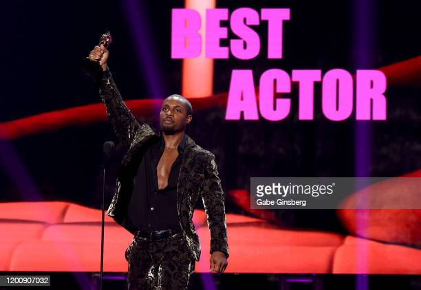 Adult film actor DeAngelo Jackson accepts the Best Actor award during the 2020 GayVN Awards show at The Joint inside the Hard Rock Hotel Casino on...