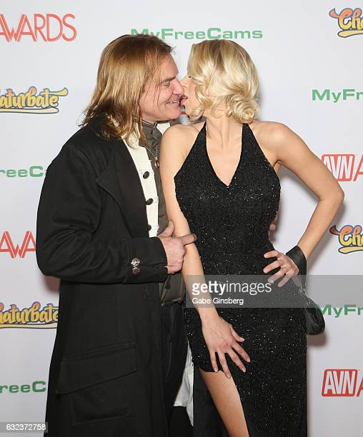 Adult film actor Evan Stone and adult film actress Katie Morgan kiss as they attend the 2017 Adult Video News Awards at the Hard Rock Hotel Casino on...