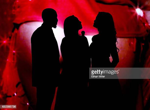 Adult film actor Isiah Maxwell, adult film actress Karlee Grey and adult film actress/director jessica drake are silhouetted as they present an award...