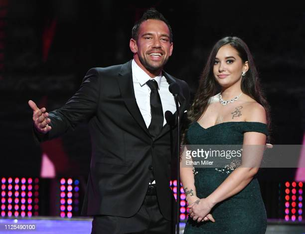 Adult film actor Johnny Castle and adult film actress Gia Paige present an award during the 2019 Adult Video News Awards at The Joint inside the Hard...