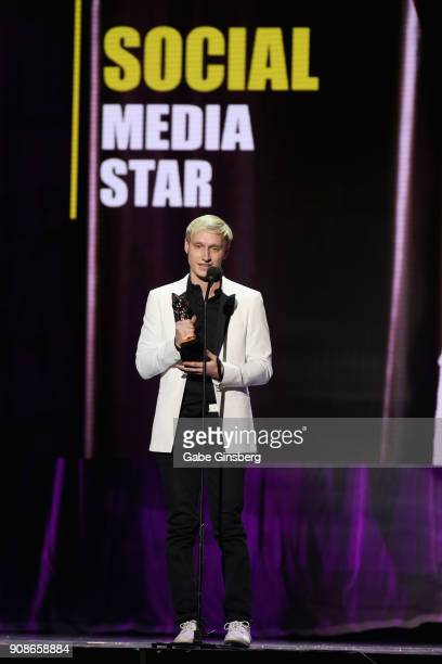 Adult film actor Max Carter wins the Social Media Star award during the 2018 GayVN Awards show at The Joint inside the Hard Rock Hotel Casino on...