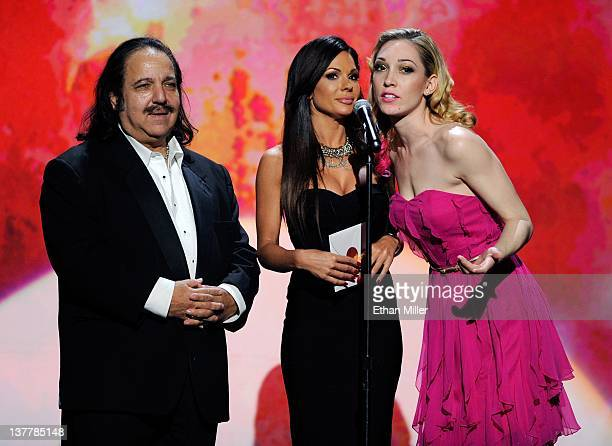 Adult film actor Ron Jeremy and adult film actresses Kirsten Price and Lily LaBeau present an award during the 29th annual Adult Video News Awards...