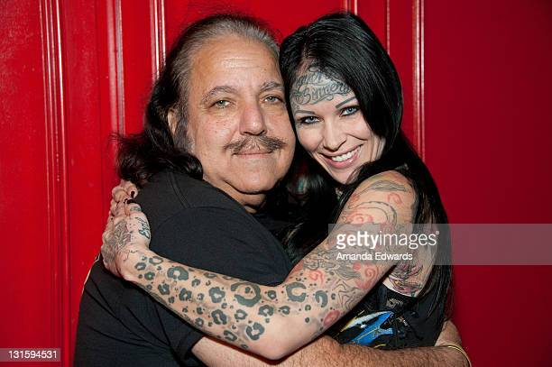 Adult film actor Ron Jeremy and model Michelle 'Bombshell' McGee pose backstage at the FilmOn 'Celebrity Fight Night' at Avalon on November 5 2011 in...