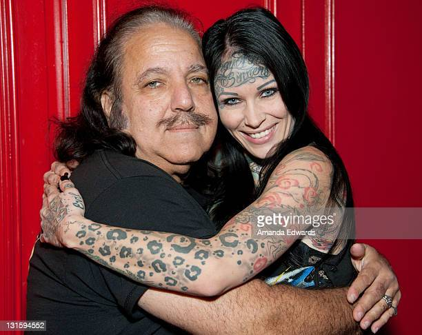Adult film actor Ron Jeremy and model Michelle Bombshell McGee pose backstage at the FilmOn Celebrity Fight Night at Avalon on November 5 2011 in...
