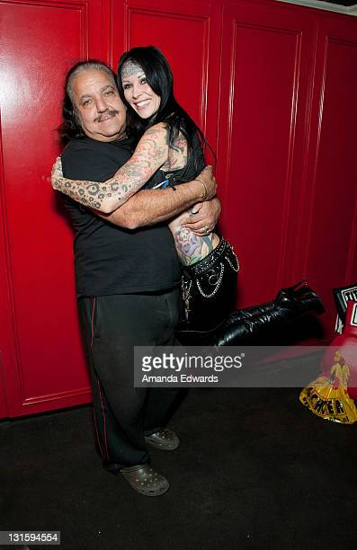 """Adult film actor Ron Jeremy and model Michelle """"Bombshell"""" McGee pose backstage at the FilmOn """"Celebrity Fight Night"""" at Avalon on November 5, 2011..."""
