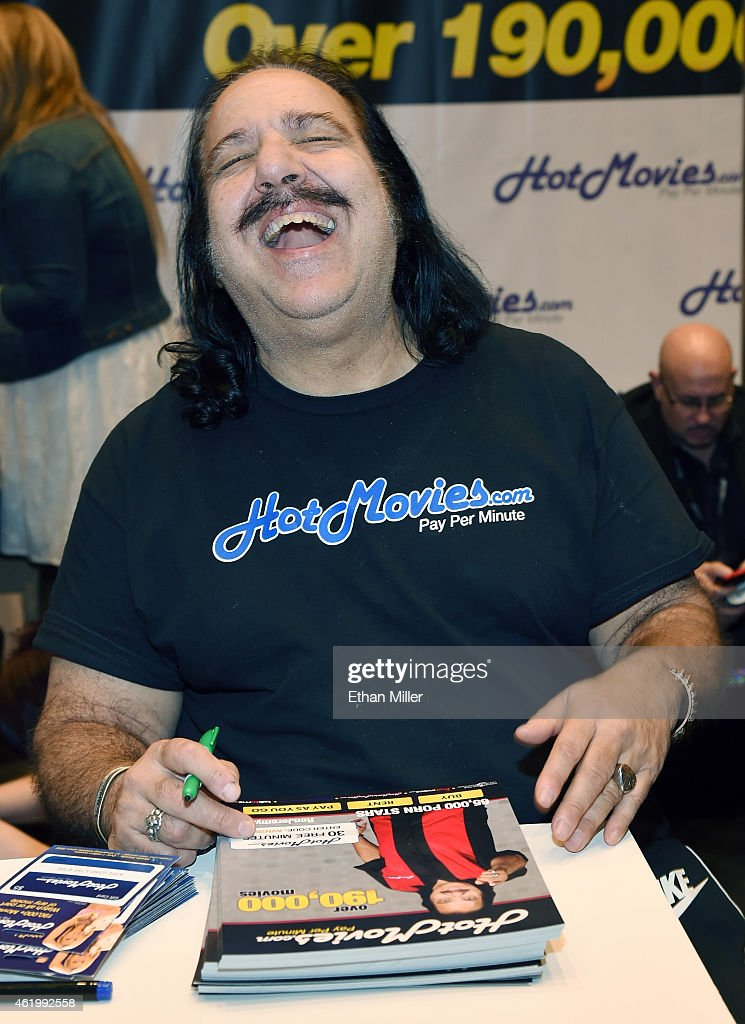 Adult film actor Ron Jeremy laughs as he signs autographs at the HotMovies.com booth at the 2015 AVN Adult Entertainment Expo at the Hard Rock Hotel & Casino on January 22, 2015 in Las Vegas, Nevada.