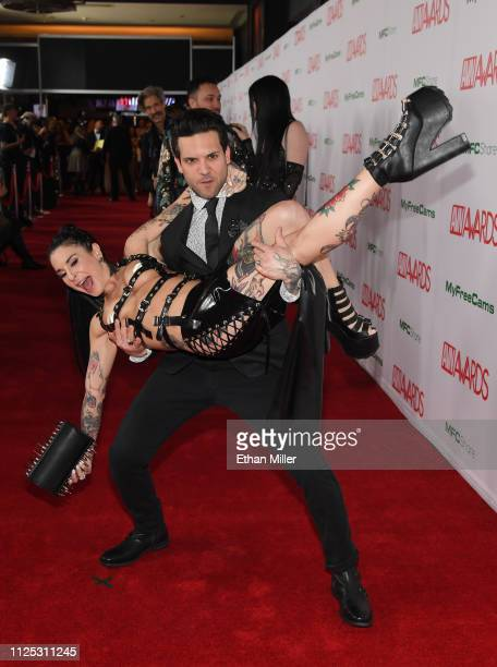 Adult film actor Small Hands picks up his wife adult film actress/director Joanna Angel as they attend the 2019 Adult Video News Awards at The Joint...