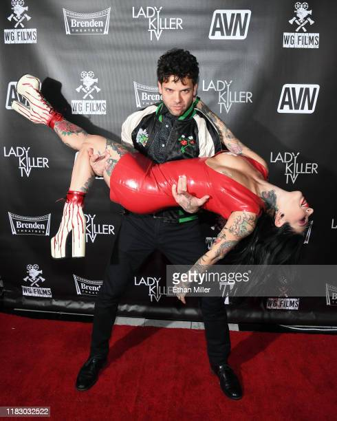 Adult film actor Small Hands picks up his wife adult film actress/director Joanna Angel as they attend the world premiere of the film LadyKillerTV at...