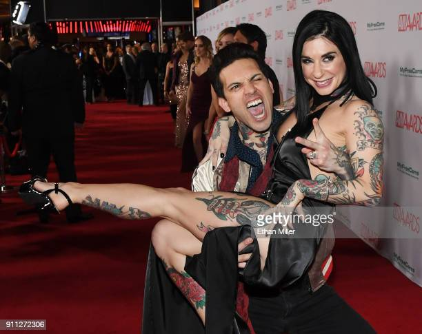 Adult film actor Small Hands picks up his wife adult film actress/director Joanna Angel as they attend the 2018 Adult Video News Awards at the Hard...