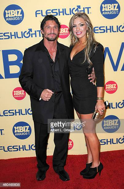 Adult film actor Tommy Gunn and adult film actress Cameron Dee arrive for the 2013 XBIZ Awards held at the Hyatt Regency Century Plaza on January 11...