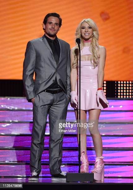 Adult film actor Tyler Nixon and adult film actress Kenzie Reeves present an award during the 2019 Adult Video News Awards at The Joint inside the...