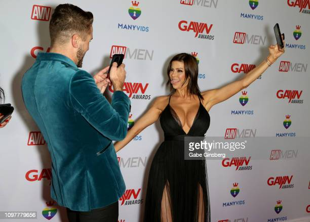 Adult film actor Wesley Woods takes photos of adult film actress Alexis Fawx during the 2019 GayVN Awards show at The Joint inside the Hard Rock...