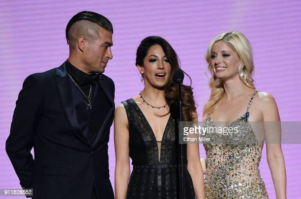 Adult film actor Xander Corvus former adult film actress/director Jenna Haze and adult film actress Charlotte Stokely present an award during the...