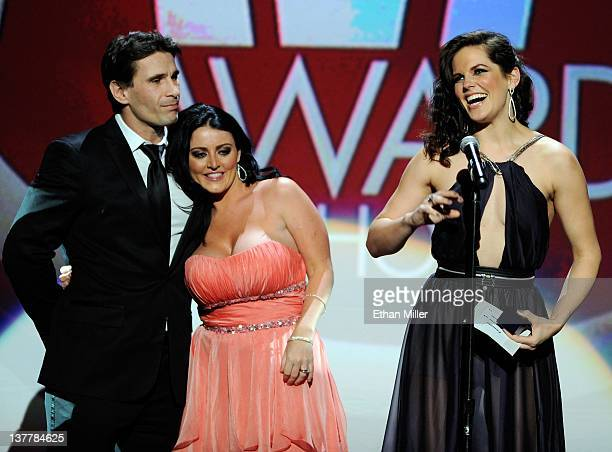 Adult film actor/director Manuel Ferrara and adult film actress Sophie Dee look on after presenting adult film actress Bobbi Starr with the award for...